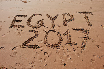 """Egypt 2017"" written in the sand on the beach"