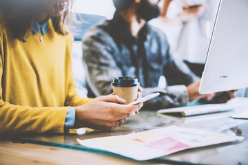 Business Startup Concept.Coworkers Meeting During Work Process.Bearded Hipster Making Great Decisions.Young Woman Using Smartphone Hand.People Working New Project Wood Desk Table.Blurred.