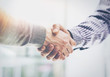Detaily fotografie Business Partnership Meeting.Photo Two Businessmans Hands Handshake Process.Successful Businessmen Handshaking After Great Deal.Horizontal, Blurred Background.