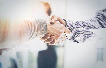 Business Partnership Meeting.Photo Two Businessmans Hands Handshake Process.Successful Businessmen Handshaking After Excellent Corporate Deal.Horizontal, Blurred Background.