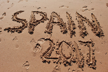 """Spain 2017"" written in the sand on the beach"