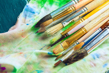 Paint brushes on wooden background