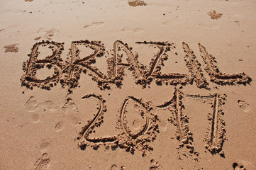 """Brazil 2017"" written in the sand on the beach"