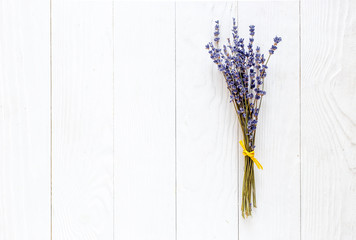 bouquet of dried lavender on wooden table top view