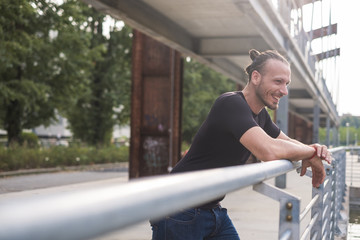 Laughing man leaning on railing