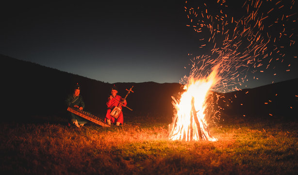 Musicians By The Camp Fire
