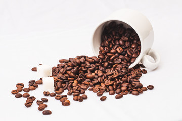 Coffee beans with white cup of coffee