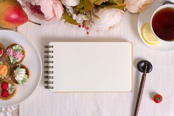 Mockup photography with flowers, notebook and pen