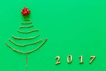 Simple christmas tree on green - original new year card