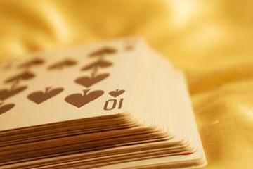 Many poker cards on cloth