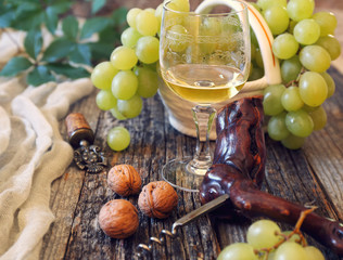 Green grapes and glass of white wine
