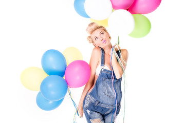 Happy pregnant girl with balloons.