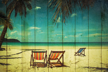 coconut tree and beach wooden bed on white sand with beautiful blue sea over clear blue sky over grunge wooden texture. vintage color tone