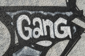 Word gang, detail of a graffiti in Milan, Italy, street art.