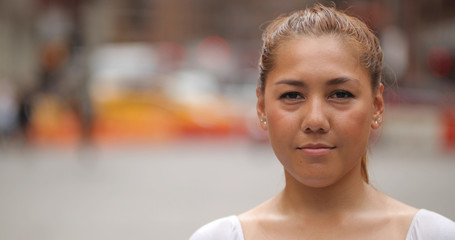 Young Latina woman in city face portrait