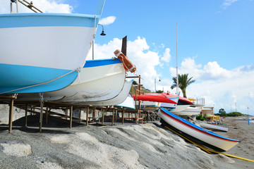 colorful fishing wooden boat moored on the beach