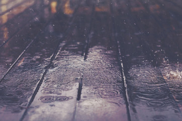 Wooden floor with rain drops, fall background