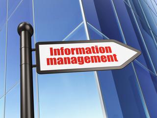 Data concept: sign Information Management on Building background