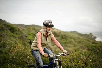 Blond teenage girl riding her bike through the countryside