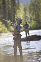 Men fishing on river