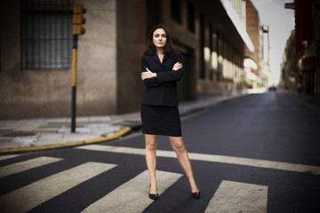 Portrait of an attractive woman posing on a roadway.