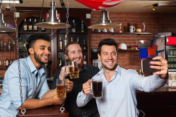 Man Group In Bar Taking Selfie Photo, Drinking Beer, Mix Race Cheerful Friends Meeting Communication