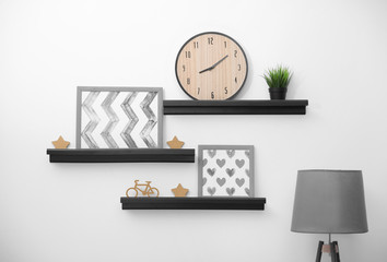 Shelves with home decor in modern room