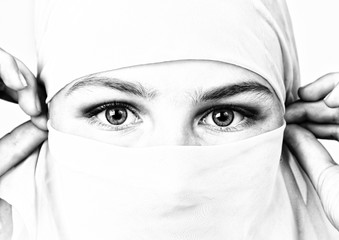 close-up beautiful mysterious eyes eastern woman wearing a hijab, black and white