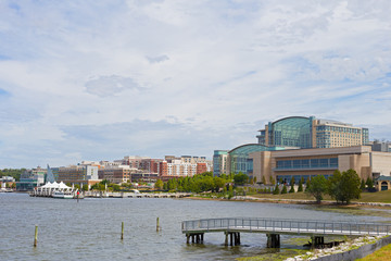 National Harbor waterfront panorama in Oxon Hill, Maryland, USA. Water transport pier services visitors coming from Washington DC.