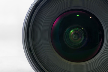Front view of black camera lens isolated on white background