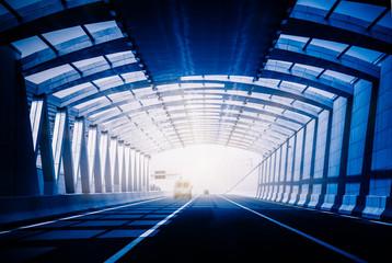 Traffic in a tunnel in blue tone.