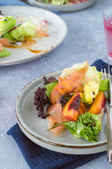 Mixed green salad with prosciutto and grilled nectarine slices