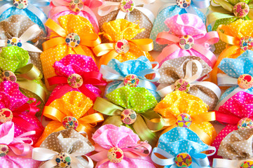 Festive background made of many colorful gift bags