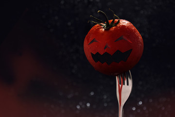 Halloween Face on Red Tomato with Fork and Bloody