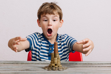 Boy wanting to take stack of money