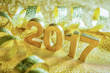 New year decoration,Closeup golden 2017 with ribbon