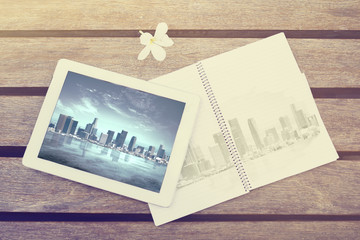 Tablet and notepad with city image