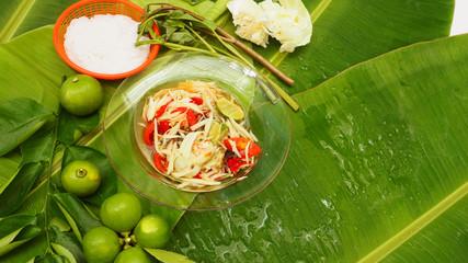 Papaya Salad and rice noodle on banana leaf