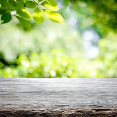 Empty wooden table with garden bokeh background with a country outdoor theme,Template mock up for display of product