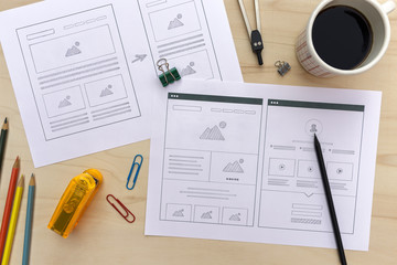 Designer desk with website wireframe sketches