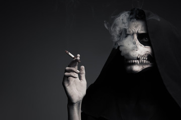 """Scary Death Makes Cloud Of Smoke. The Concept """"Smoking Kills""""."""