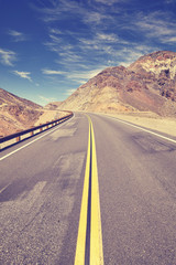 Vintage toned mountain road in Death Valley, travel concept, USA.