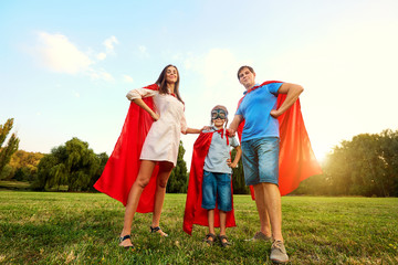 Superheroes family. Mother, father and son in the costumes of su