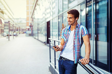 Handsome man listen to music on smart phone