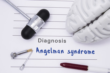 Diagnosis of Angelman syndrome. Neurological hammer and brain figure lie on a medical paper form with a heading diagnosis of Angelman syndrome on a table in the office of a neurologist