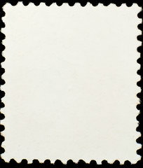 The blank postage stamp close-up isolated on black background