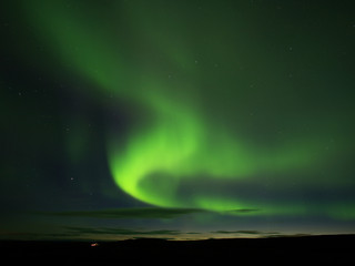 Northern lights in Reykjahlíð near Mývatn lake
