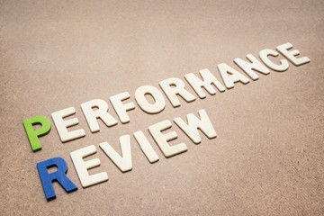 Performance review text on brown background
