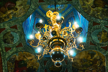 Church chandelier lighted