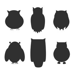 Collection black silhouettes of owls isolated from the background.